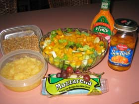 The Johnsons, Christy and Tom, like to try new recipes and create their own. Christy created this salad as a light meal for summer after her workouts at the gym. Her husband, Tom, likes to cook also, and his Shredded Chicken Sandwich recipe appears below. Goes great with this salad.